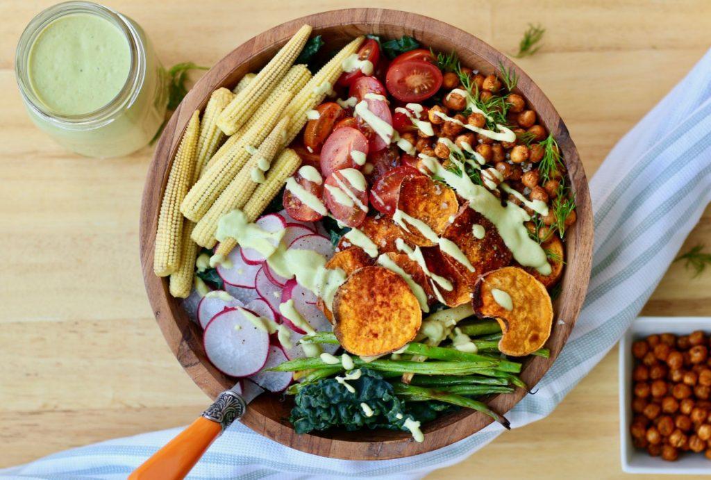 Kale Salad with sweet potato, chickpeas, corn, radish, green beans and tomato